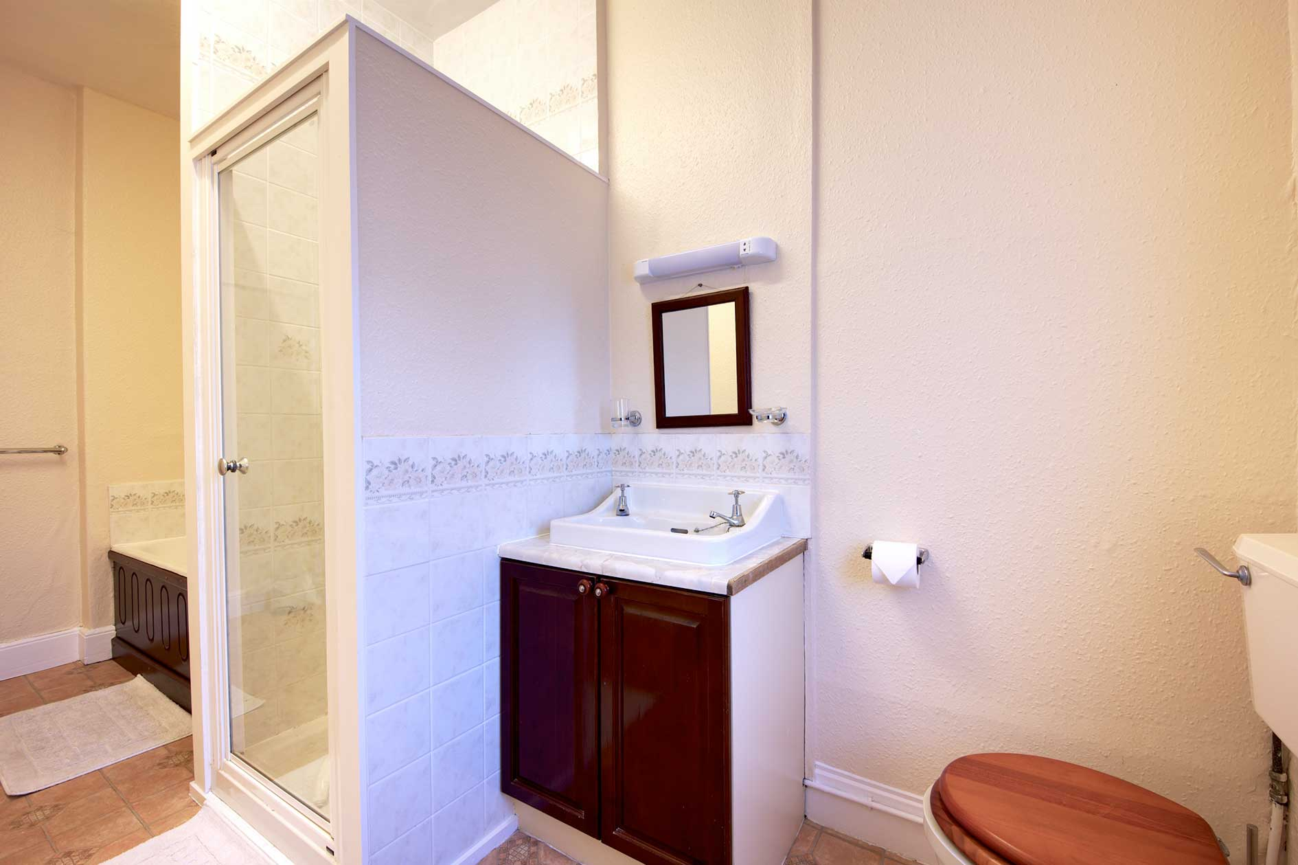 Bathroom With Shower Cubicle, Bath, Sink And Toilet