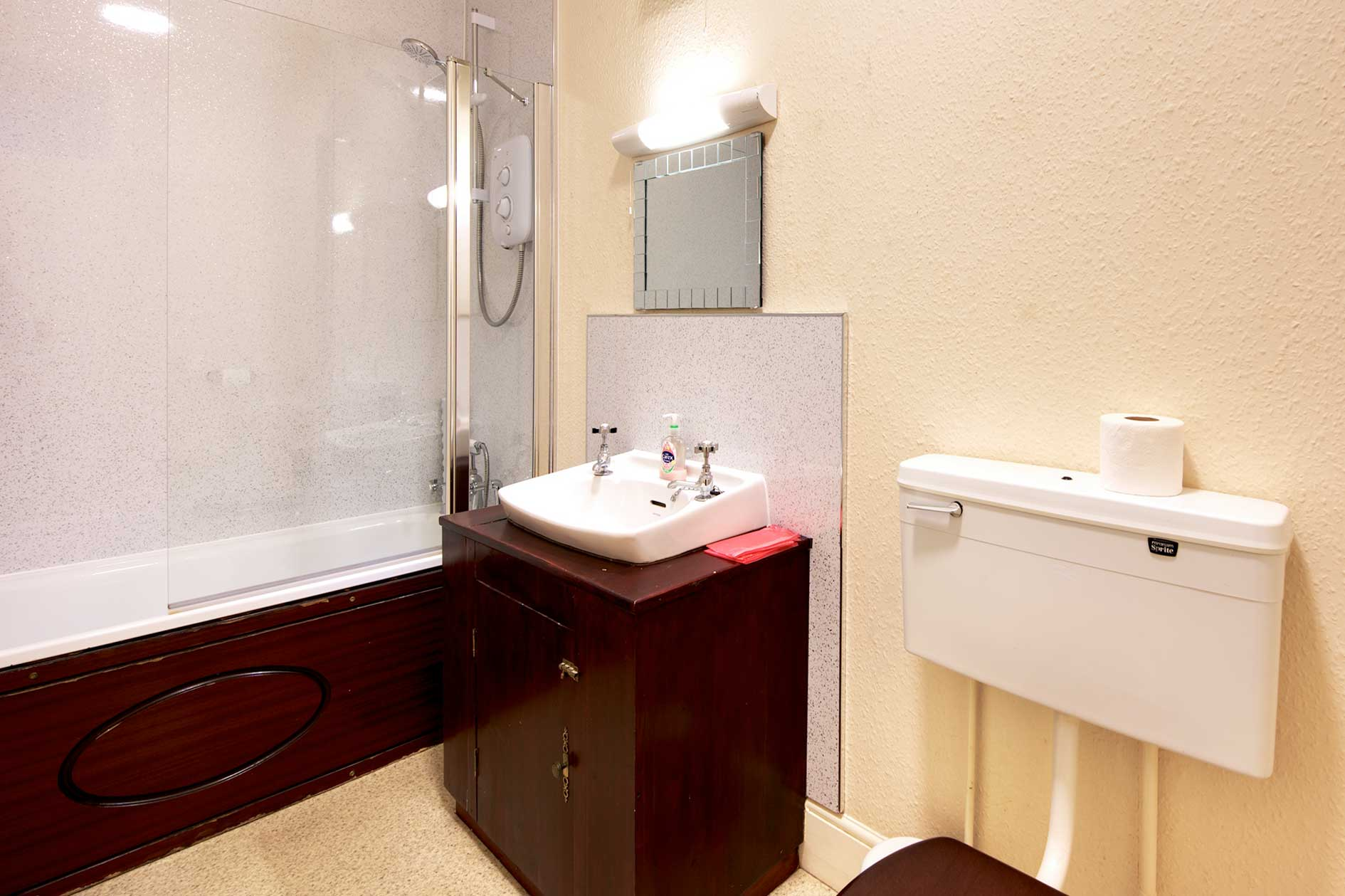 Light Bathroom With Shower Bath, Sink And Toilet