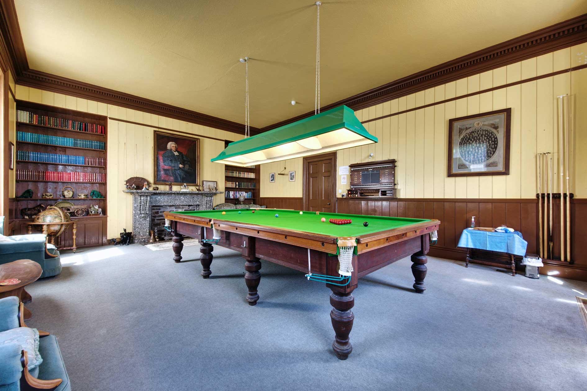 Snooker Room With Bookcase And Period Portrait On Wall